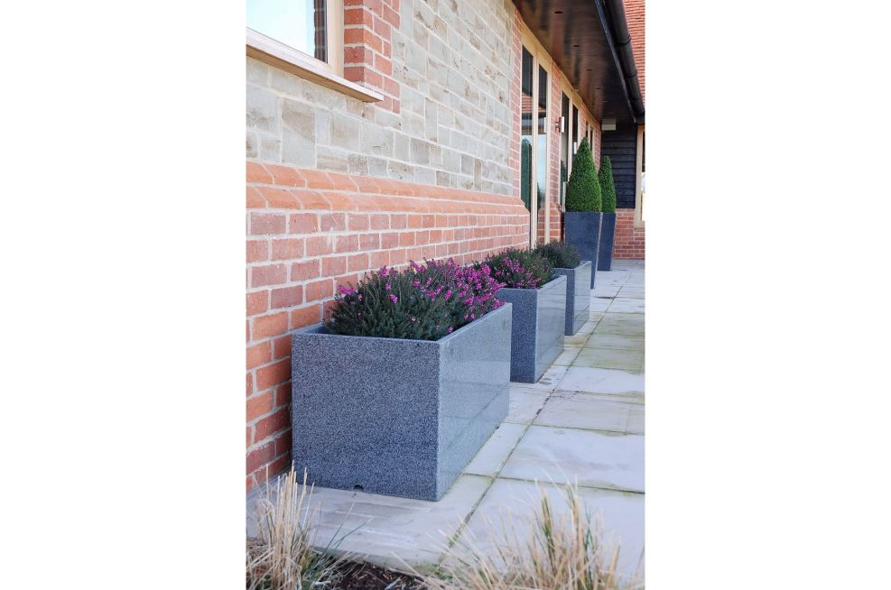 Trough 1000 Granite Planters And Tall Taper XXL in The Background
