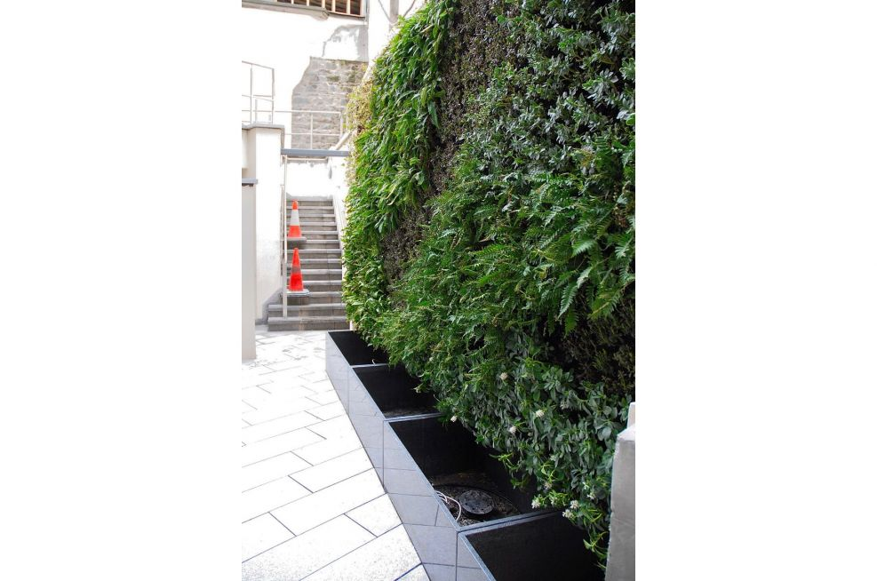 Green Wall System Integrated with Bespoke Natural Stone Granite Planters