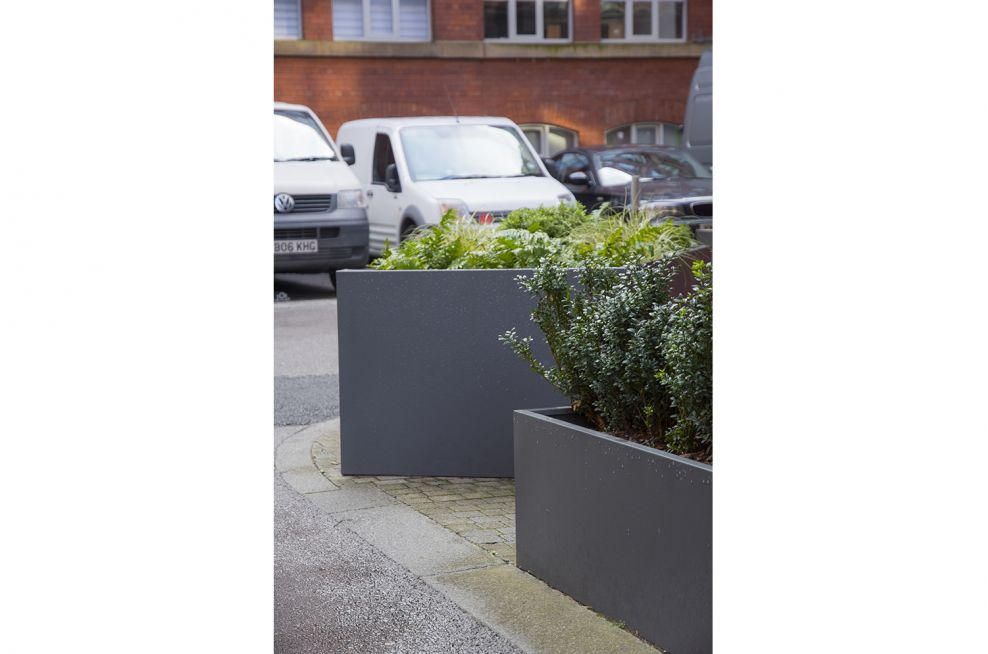 Close Up Of External Steel Planters Outside the Property