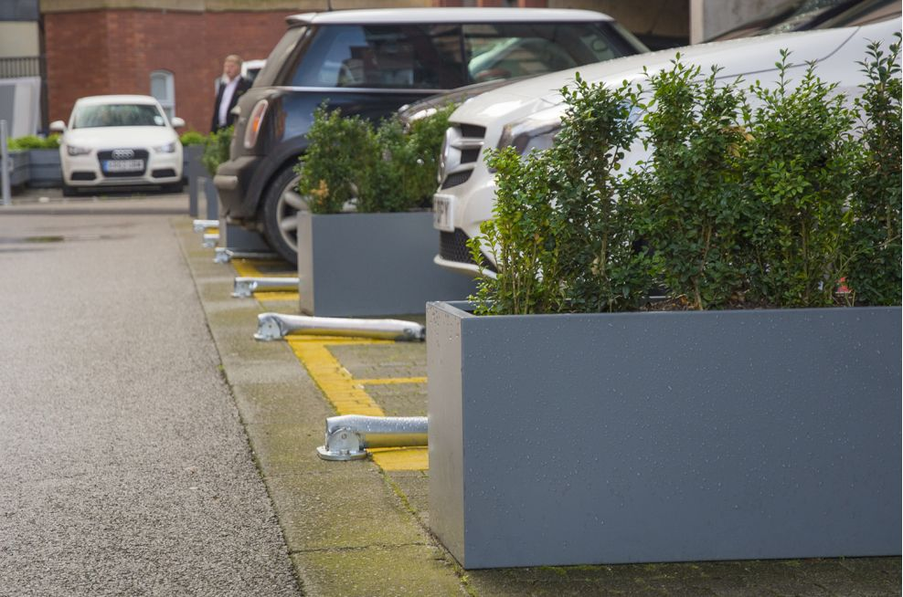 Steel Planters Used To Seperate Parking Spaces