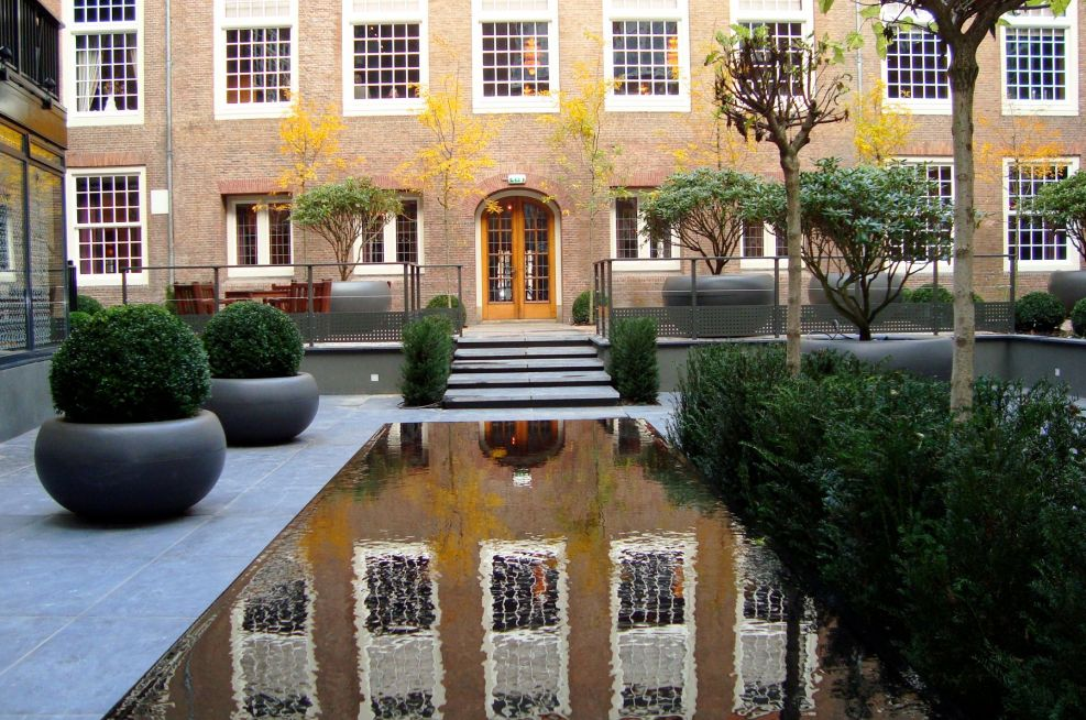 Large Aladin Planters In Courtyard