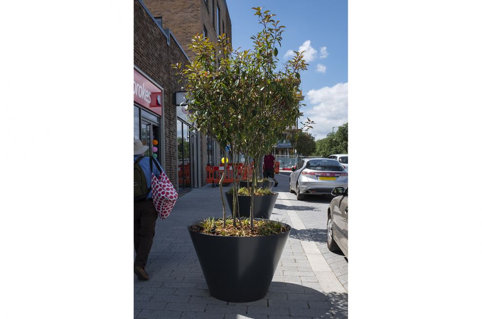 Large flared cone shaped public planters