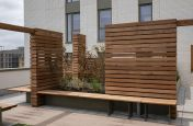 Planters with timber benches and windbreaks