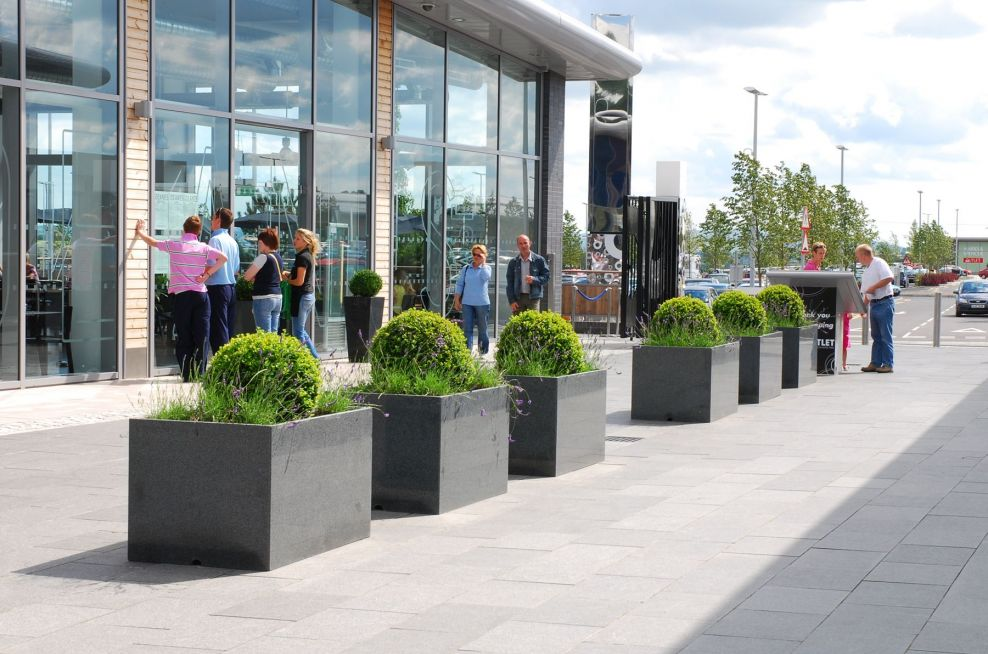 Lines Of Granite Planters Outside The Outlet