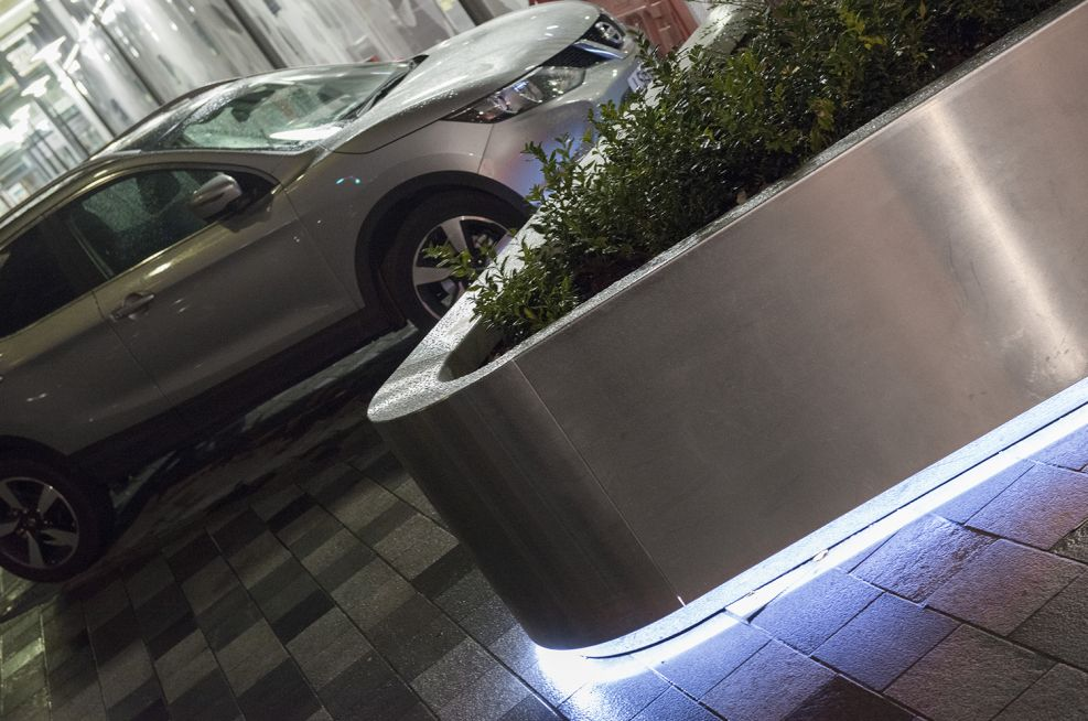 Bespoke stainless steel tree planters at University College Hospital [UCH]