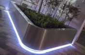 IOTA's planters at the new ambulance drop-off station for UCH, off Grafton IOTAs Stainless Steel Illuminated Planters