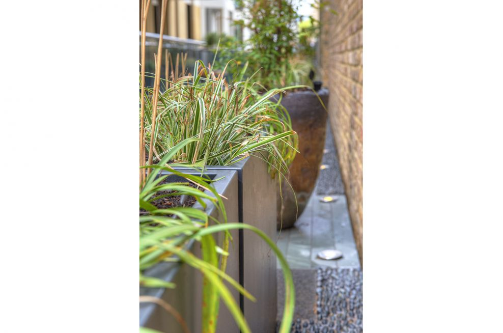 Steel Trough Planters Overlooking Apartments