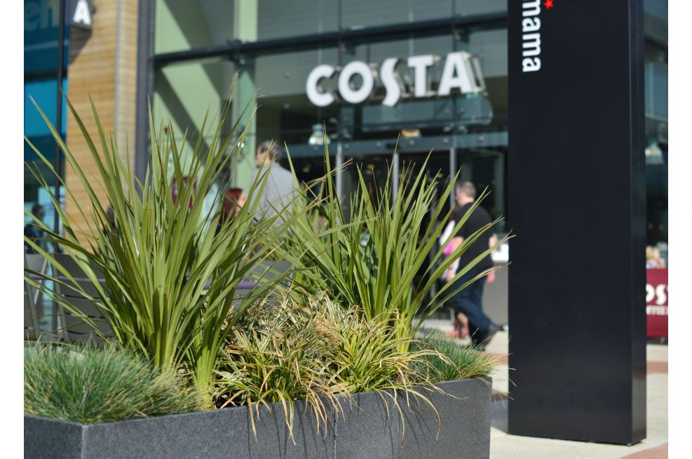Granite Trough 1000 Planters Surround The Outdoor Seating Area