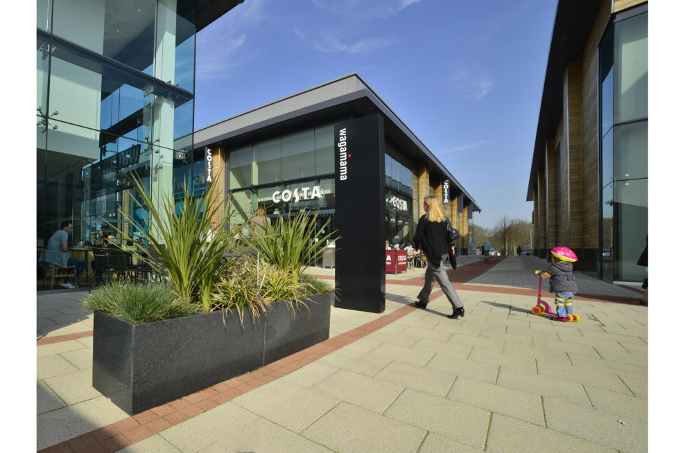 Trough 1000 Granite Planters Used On External Paving
