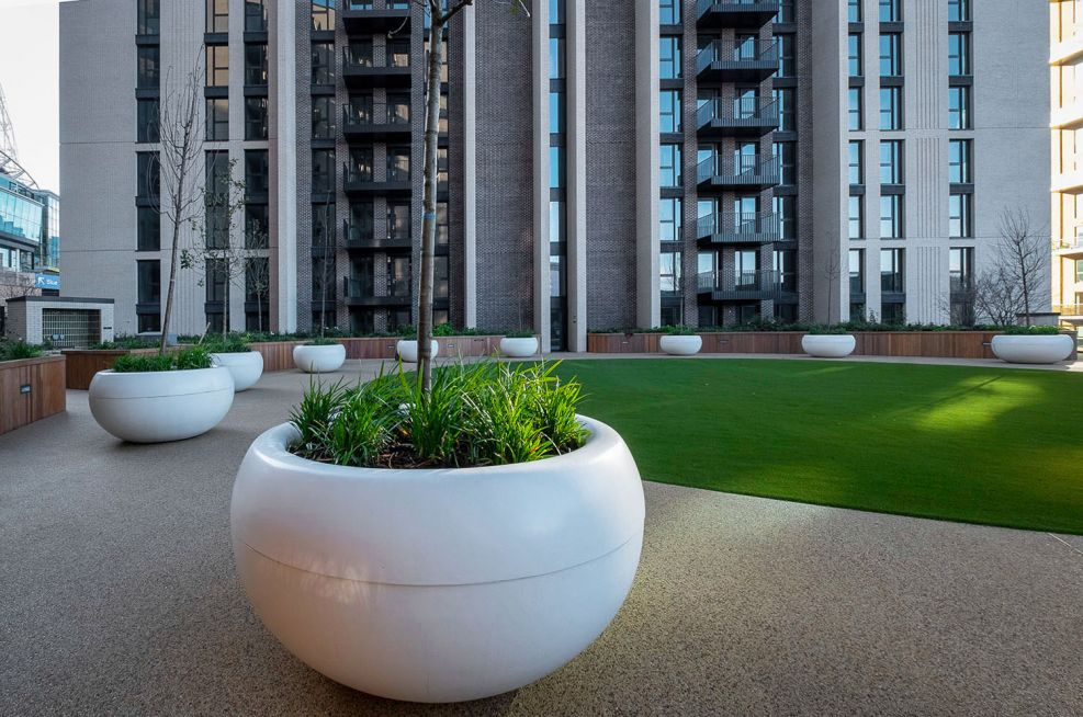 Round white planters for public landscaping
