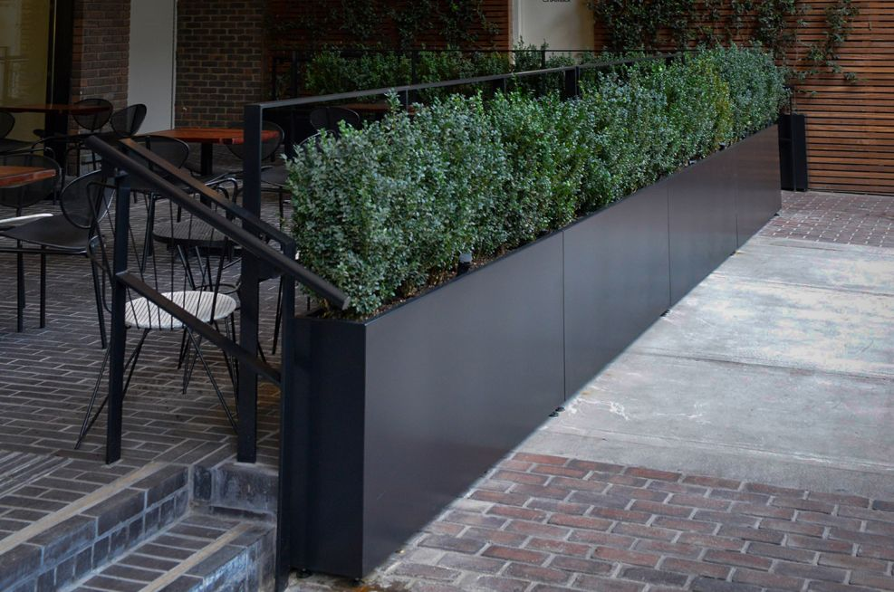 Slim boundary planters for seating