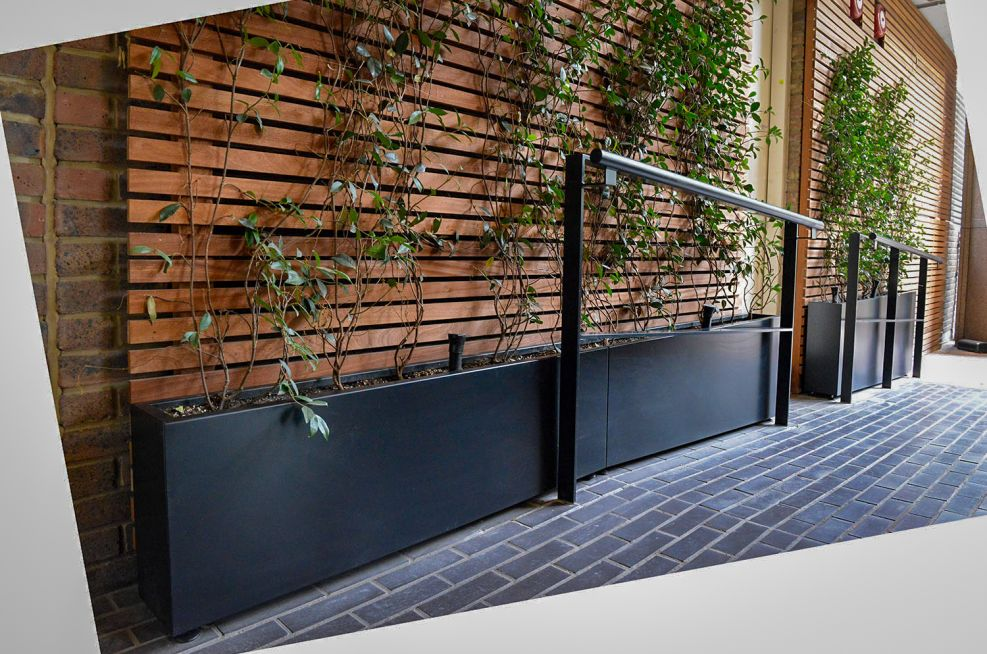 Sloped planters alongside walkway