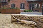 Large Corten Steel Planter And Wooden Carving