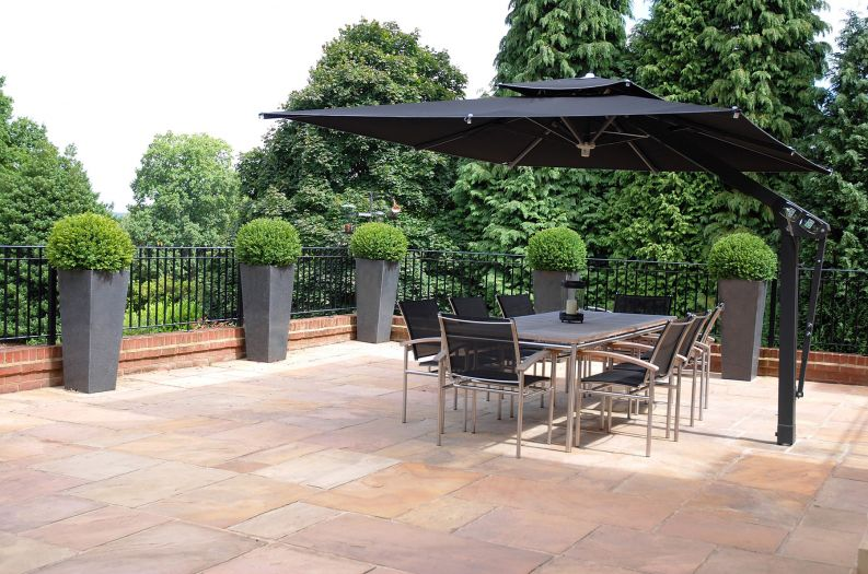 Granite Tall Taper XXL planters on the outdoor dining terrace