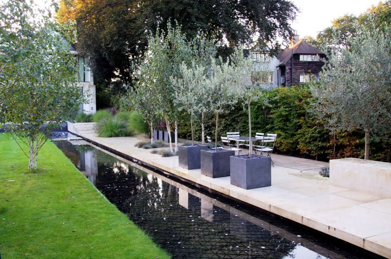 Granite Cube 600 planters next to a water rill at a private residence
