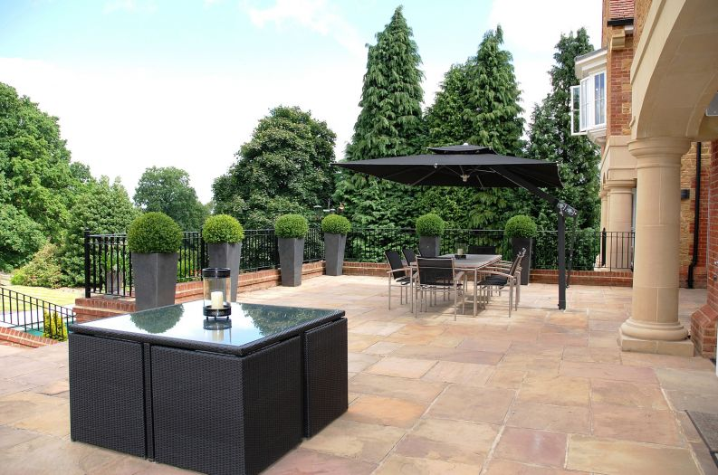 Granite Tall Taper XXL planters on an outdoor dining terrace