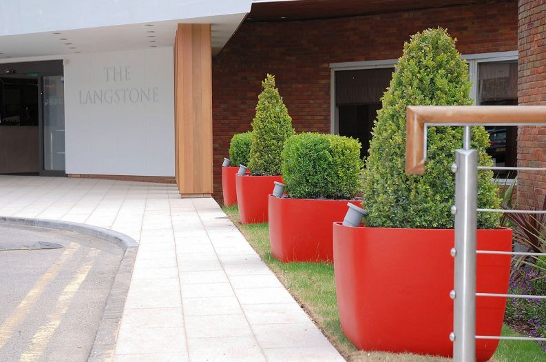 Custom coloured Boulevard planters at The Langstone Hotel.