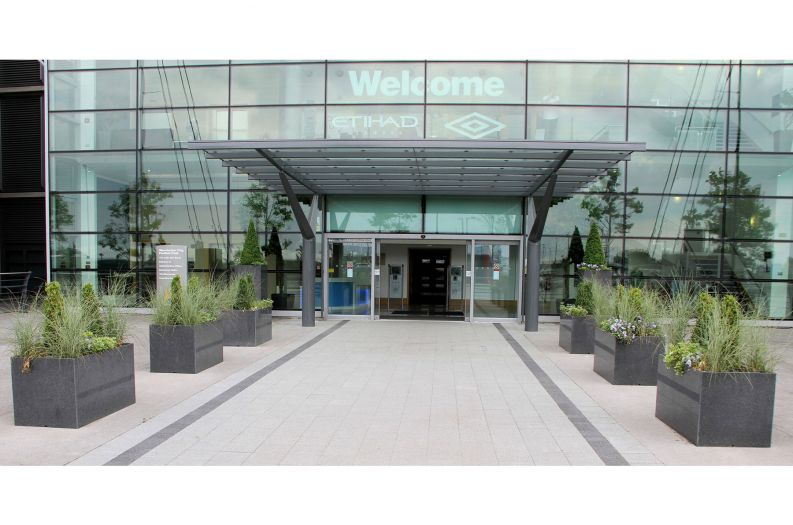 Custom granite planters at the entrance to The City of Manchester Stadium